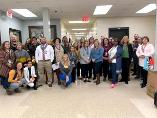 "The West Nassau High School Beta Club's ""Project TRIBE"" initiative led faculty and staff to wear Mardi Gras beads Monday. Each student was given a set of beads and a thank you note to give to a staff member who has made an impact on them."