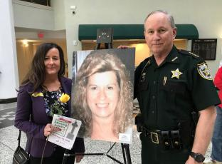 Sheriff Bill Leeper meets with Jackie Markham's daughter at the 10th annual Missing Adults Day at Jacksonville City Hall Feb. 28. Markham is one of six missing adults from Nassau County who were included in the 48 individuals highlighted during the ceremony.