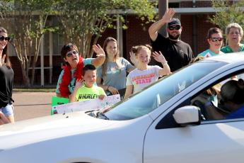 Students and parents parade through the bus loop at Callahan Elementary School Friday morning during the Fairwell Faircloth parade. Principal Sabrina Faircloth, wearing the red boa, is retiring. Current Assistant Principal Melissa Johnson will serve as principal for the 2020-21 school year.