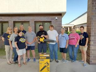 The Callahan Middle School PTO presents the school custodians with a Dewalt rechargeable battery-operated leaf blower May 20. The PTO also presented all 72 CMS teachers, staff members and administrators with $40 gift cards to thank them for all they do.