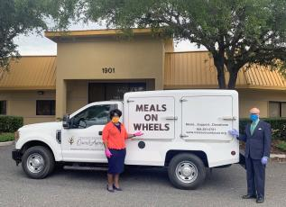NCCOA President and CEO Janice Ancrum and  HR and Compliance Director Don Harley showcase one of the new Meals  on Wheels trucks.
