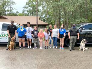 Children from Florida Sheriff's Youth Ranch in Live Oak visit Camp Sorensen in Callahan recently. The Nassau County Sheriff's Office provided law enforcement demonstrations to the kids.