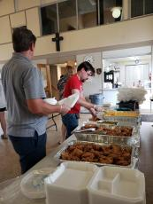Volunteers fill to-go boxes at the free Callahan Community Dinner, available every Wednesday from 5-6 p.m. Meals are available for takeout only at First United Methodist Church of Callahan. Donations welcome.