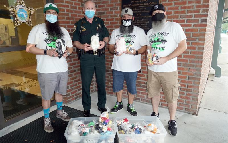 The Bearded Villains Volunteer Group delivers a little over 100 beanie babies, sanitized and prepackaged, to the Nassau County Sheriff's Office for deputies to distribute to children in the community. These were donated by Katherine Hargesheimer and her family.