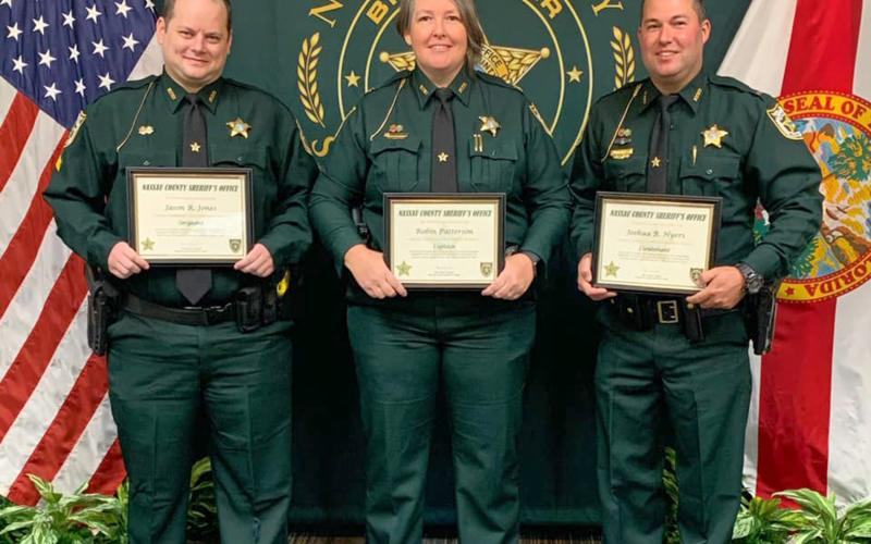 Three employees of the Nassau County Sheriff's Office are employed under higher ranks after a promotion ceremony was held Oct. 9.  Detention Deputy Jason Jones, far left, was promoted to sergeant in Corrections, Detention Sergeant Josh Hyers was promoted to lieutenant in Corrections and Lieutenant Robin Patterson was promoted to captain in Administrative Services.