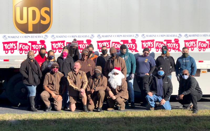 UPS stepped up and brought two semis, two vans and 18 employees to deliver Toys for Tots.